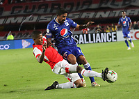 BOGOTÁ- COLOMBIA, 01-05-2019:Fainer Torijano (Izq.) jugador del Independiente Santa Fe    disputa el balón contra Christian Marrugo (Der.) jugador de Millonarios  durante partido por la fecha 19 de la Liga Águila I  2019 jugado en el estadio Nemesio Camacho El Campín  de la ciudad de Bogotá. /Fainer Torijano (L) player of Independiente Santa Fe  fights for the ball  against of Christian Marrugo(R) player of Millonarios during the match for the date 19 of the Liga Aguila I 2019 played at the Nemesio Camacho El Campin  stadium in Bogota city. Photo: VizzorImage / Felipe Caicedo / Staff