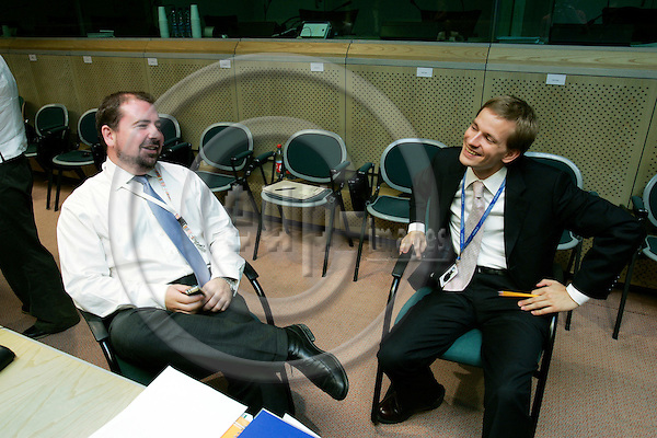 BRUSSELS - BELGIUM - 28 JULY 2006 -- Lauri VOIONMAA, Attache Foreign Relation Counsellors, the Permanent Representation of Finland to the EU speaking with his Irish counterpart Kyle Michael O'SULLIVAN at the RELEX-meeting in the EU Council. -- PHOTO: ERIK LUNTANG / EUP-IMAGES..
