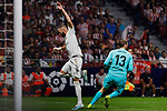 Jan Oblak of Atletico de Madrid and Karim Benzema of Real Madrid during La Liga match between Atletico de Madrid and Real Madrid at Wanda Metropolitano Stadium in Madrid, Spain. September 28, 2019. (ALTERPHOTOS/A. Perez Meca)