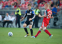 27 August 2011: Toronto FC defender Richard Eckersley #27 and San Jose Earthquakes midfielder Bobby Convey #11 in action during a game between the San Jose Earthquakes and Toronto FC at BMO Field in Toronto.