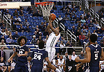 Nevada's Tyron Criswell (2) shoots over Utah State defenders, from left, Jalen Moore (24), JoJo McGlaston (24) and Julion Pearre (5) during an NCAA college basketball game in Reno, Nev., on Tuesday, Jan. 20, 2015. (AP Photo/Cathleen Allison)