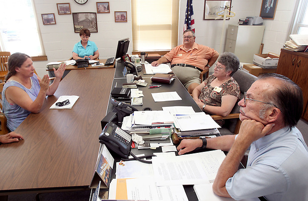 Julie Bowers meets with the Poweshiek County Board of Supervisors while trying to agree on a contractual restoration agreement between the board and the North Skunk River Greenbelt Association.  The board owns the McDowell bridge and of the land it sits on and the NSRGA needed legal permission to begin the restoration.  An agreement was never struck.