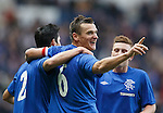 Lee McCulloch celebrates his goal and Rangers third