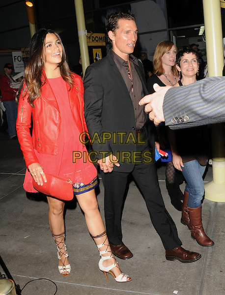 "CAMILA ALVES & MATTHEW McCONAUGHEY.at The Nobelity Project's inspiring new feature documentary ""One Peace At A Time"" held at The Arclight Theatre in Hollywood, California, USA, .October 21st 2009..full length red leather jacket couple pregnant maternity top maternity holding hands brown shirt grey gray black suit   white lace up strappy sandals shoes open toe                                                             .CAP/RKE/DVS.©DVS/RockinExposures/Capital Pictures."