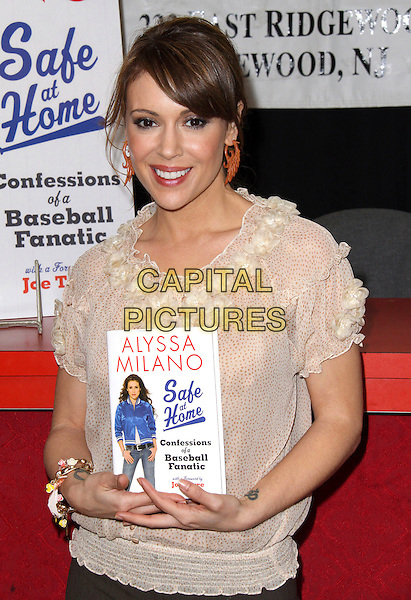 "ALYSSA MILANO.Book Signing for  ""Safe at Home: Confessions of a Baseball Fanatic"" held at Bookends Book Store, Ridgewood, New Jersey, USA, .31st March 2009..half length book cream beige top ruffle sheer .CAP/ADM/PZ.©Paul Zimmerman/Admedia/Capital Pictures"