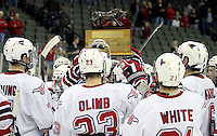 UNO celebrates with the Spirit of the Maverick trophy after sweeping its first ever WCHA home series. University of Nebraska Omaha beat Minnesota State-Mankato 5-2 on Saturday night at Qwest Center Omaha. The trophy is awarded annually to the winner of the UNO/MSU series. (Photo by Michelle Bishop)