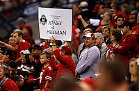 An Ohio State fan makes his appeal to give Ohio State Buckeyes quarterback Cardale Jones (12) the Heisman Trophy during the first quarter of the Big Ten Championship game against the Wisconsin Badgers at Lucas Oil Stadium in Indianapolis on Dec. 6, 2014. (Adam Cairns / The Columbus Dispatch)