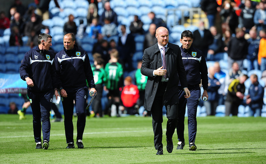 From left, Burnley's First-team coach Tony Loughlan, Burnley's Assistant manager Ian Woan, Burnley manager Sean Dyche and Burnley's Goalkeeping Coach Billy Mercer <br /> <br /> Photographer Chris Vaughan/CameraSport<br /> <br /> Football - Barclays Premiership - Burnley v Stoke City - Saturday 16th May 2015 - Turf Moor - Burnley<br /> <br /> &copy; CameraSport - 43 Linden Ave. Countesthorpe. Leicester. England. LE8 5PG - Tel: +44 (0) 116 277 4147 - admin@camerasport.com - www.camerasport.com