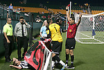 26 August 2011: Referee Jose Carlos Rivero (right) shows the red card to Harrisburg's Brian Ombiji (KEN) after Ombiji knocked Rochester's Connor Tobin (left, below) through a signboard. Rochester's Neal Kitson (1) checks on his teammate. The Harrisburg City Islanders defeated the Rochester Rhinos 2-1 in their USL PRO semifinal played at Sahlen's Stadium in Rochester, New York.