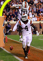 CHARLOTTESVILLE, VA- NOVEMBER 12: Running back David Wilson #4 of the Virginia Tech Hokies celebrates a touchdown with wide receiver Danny Coale #19 of the Virginia Tech Hokies during the game against the Virginia Cavaliers on November 28, 2011 at Scott Stadium in Charlottesville, Virginia. Virginia Tech defeated Virginia 38-0. (Photo by Andrew Shurtleff/Getty Images) *** Local Caption *** David Wilson;Danny Coale