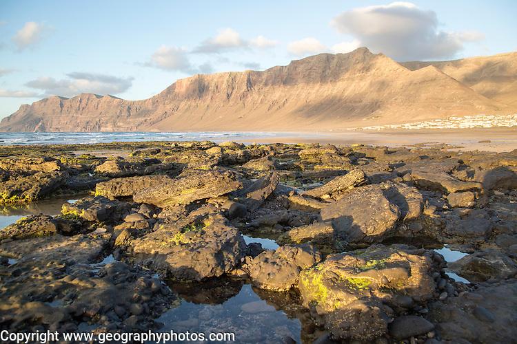 Lanzarote, Canary islands, SpainLate afternoon light on beach and cliffs La Caleta de Famara, Lanzarote, Canary islands, Spain