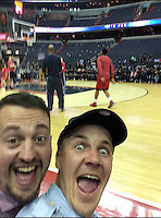 COPY BY TOM BEDFORD MEDIA<br /> Pictured: Matt Evans (R) friend Rusty Ware watching basketball in the USA<br /> Re: Former postman, lotto Millionaire Matt Evans, 35, from Barry, south Wales, who has been spending his winnings to travel the world to watch various sports events.