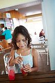 FRENCH POLYNESIA, Moorea. Fiona having a drink.
