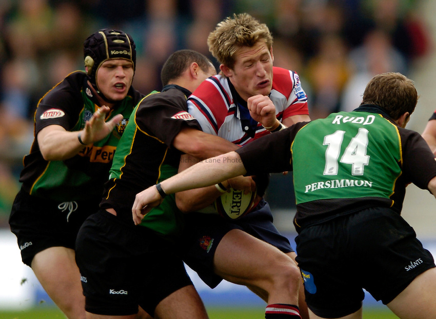 Photo. Richard Lane..Northampton Saints v Gloucester. Zurich Premiership. 18/09/2004..James Forrester is hit by the Saints defence.