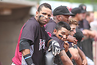 Wisconsin Timber Rattlers third baseman Sthervin Matos (9) and outfielder Brandon Diaz (5) in the dugout during a Midwest League game against the Kane County Cougars on May 16th, 2015 at Fox Cities Stadium in Appleton, Wisconsin.  Kane County defeated Wisconsin 4-2.  (Brad Krause/Four Seam Images)