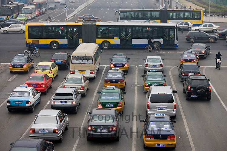 Bendybus and traffic on Beijing main street, China
