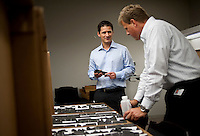 Norwegian employees of the European company StatOil, Lars Erik Oino (cq,44, right), a geologist from Oslo, and Eivind Vamraak (cq, 37) a mid steam engineer, from Stavanger, discuss shale ore samples at Chesapeake Energy's headquarters in Oklahoma City, OK, Thursday, Sept., 23, 2009. Chesapeake Energy has a new program to work with foreign companies to help train on new shale technology...PHOTOS/ MATT NAGER