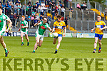 St Senans Donal Hunt under pressure from Andrew Barry   in the Junior Premier football championship final on Sunday.