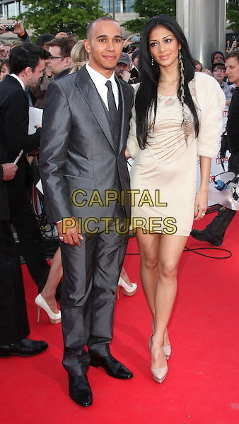 LEWIS HAMILTON & NICOLE SCHERZINGER .National Movie Awards 2011 at Wembley Arena, London, England, UK, .May 11th 2011..full length grey gray suit tie cream beige dress fur coat jacket bolero nude shoes platform feather in hair couple.CAP/ROS.©Steve Ross/Capital Pictures