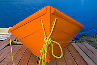 Orange boat on dock<br /> Frenchman Cove<br /> Newfoundland <br /> Canada
