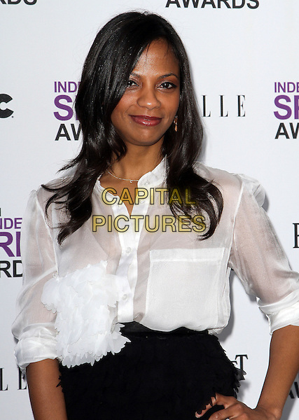 Cisely Saldana.2012 Film Independent Spirit Awards held at Santa Monica Beach, Santa Monica, California, USA, .25th February 2012..indie indies half  length white shirt black skirt .CAP/ADM/KB.©Kevan Brooks/AdMedia/Capital Pictures.