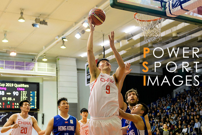 Quan Gu of China (L) in action during the FIBA Basketball World Cup 2019 Asian Qualifier Group A match between Hong Kong and China at Southorn Stadium on February 26, 2018 in Hong Kong. Photo by Marcio Rodrigo Machado / Power Sport Images