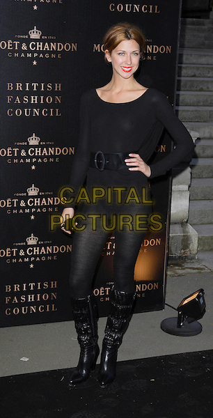 MARGOT STILLEY.Attending the Moet Mirage Party to celebrate Moet & Chandon Champagne's 10 Year Partnership with the British Fashion Council and London Fashion Week. .Opera Holland Park, London, England, .September 16th 2007..full length black hand on hip tights stilly pants knickers jumper belt top knee high boots.CAP/ROS.©Steve Ross/Capital Pictures
