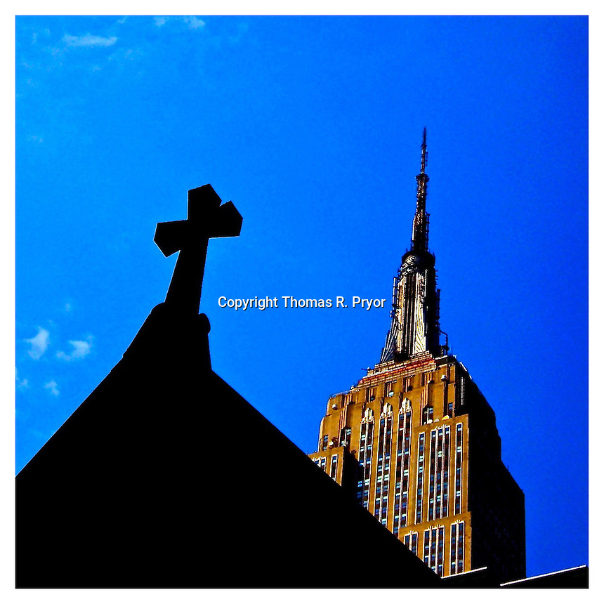 NEW YORK, NY - JULY 9: Empire State Building from Madison Square Park in New York, New York on with church's cross shadow in mid town July 9, 2010. Photo Credit: Thomas R Pryor