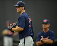 NWA Democrat-Gazette/ANDY SHUPE<br /> Ole Miss pitcher Gunnar Hoglund warms up Friday, June 7, 2019, during practice in The Fowler Family Baseball and Track Training Center ahead of today's NCAA Super Regional game at Baum-Walker Stadium in Fayetteville. Visit nwadg.com/photos to see more photographs from the practices.