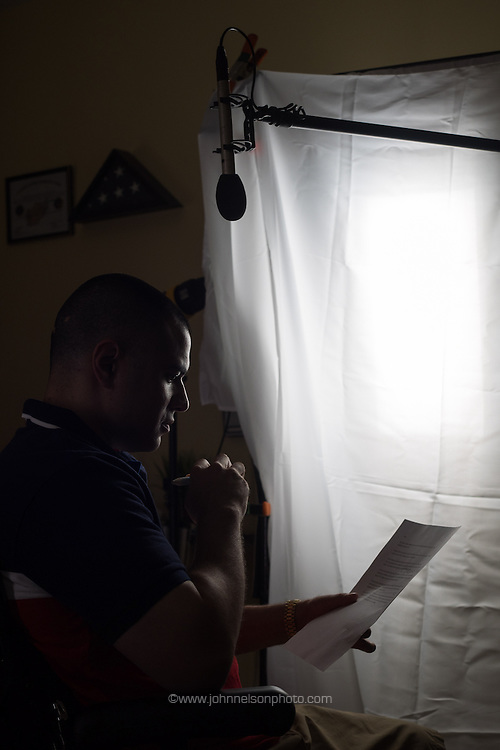 Afganistan war vet Josh Himan goes over a script before taping a video segment at his family's home in Woodbridge, VA.