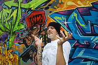 Providence, RI 2010 - Local graffiti legend Wizart served time under harsh penalties set by Providence officials. Graffiti writers still work undercover evading police and local goverment crackdowns but they now have 'legal' walls such as here at Yarrow's Cans where Wizart has produced a masterpiece.