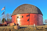 "The Round Barn in Arcadia Oklahoma was built by William Oder in 1998 and served as a home for cattle.  The barn is 60' in diameter and 45' tall.  The barn's  second  story was also used as a place for dances for the locals.  The barn has  become one of the best known Route 66 landmarks in the country and was placed on the National Register of Historic Places in 1977.  In 1998 the barns roof collapsed and Knowing it would be no small feat, Luther ""Luke"" Robison (a retired building contractor) had long admired the Round Barn and decided that he would save it from utter ruin. He and the Over the Hill Gang, (a group of retirees) volunteered their time, money and skill to the task. The barn is now completely restored and open to the public."