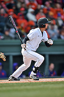South Carolina center fielder Gene Cone (19) swings at a pitch during a game against the Clemson Tigers at Fluor Field February 28, 2015 in Greenville, South Carolina. The Gamecocks defeated the Tigers 4-1. (Tony Farlow/Four Seam Images)