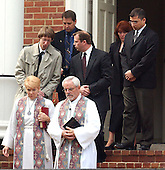 """Arlington, VA - October 21, 2002 -- Reverend Nancy Childress, left, and Reverend Larry Tingle, right,  lead family members from the funeral of Linda Franklin from Mount Olivet United Methodist Church, in Arlington, VA on 21 October, 2002.  Ms. Franklin was shot and killed by the """"Beltway Sniper"""" last Monday as she shopped at the Home Depot in the Seven Corners Shopping Center.<br /> Credit: Ron Sachs / CNP<br /> (RESTRICTION: NO New York or New Jersey Newspapers or newspapers within a 75 mile radius of New York City)"""