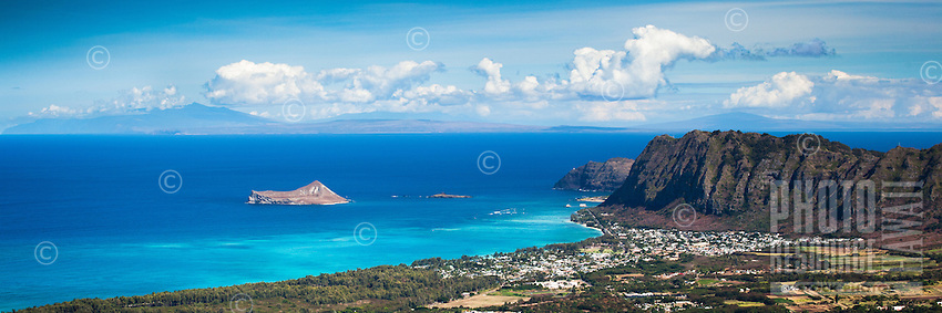 A panorama including the outer Islands viewed from the top of Mt. Olomana, Windward O'ahu; Waimanalo Beach, the Ko'olau Mountains and Rabbit and Bird Islands are also visible.