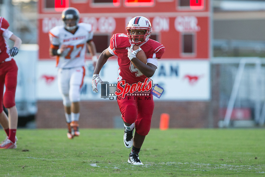 David Broaddus (4) of the East Rowan Mustangs runs with the football during first half action against the Northwest Cabarrus Trojans at East Rowan High School on October 8, 2015, in Salisbury, North Carolina.  The Trojans defeated the Mustangs 30-13.  (Brian Westerholt/Sports On Film)