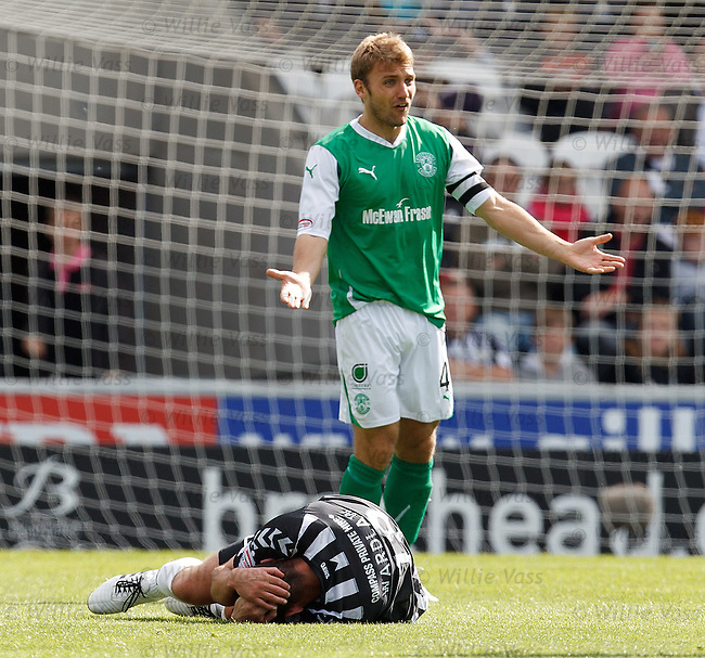 Chris Hogg clatters Gareth Wardlaw from behind