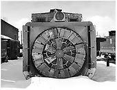 C&amp;TS rotary snow plow OM front view in Chama yard with engine house to left.<br /> C&amp;TS  Chama, NM  Taken by Payne, Andy M. - 3/23/1975