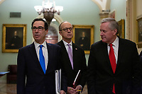 United States Secretary of the Treasury Steven T. Mnuchin, White House Director of Legislative Affairs Eric Ueland, and United States Representative Mark Meadows (Republican of North Carolina) speak to members of the media as they arrive to the United States Capitol in Washington D.C., U.S. on Tuesday, March 24, 2020.  The Senate is working to finalize a deal on the Coronavirus Stimulus Package, after it was blocked by Senate Democrats two days in a row.  Credit: Stefani Reynolds / CNP/AdMedia