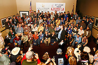 Millenium hotel general manager, Sue Kenyon , toasts the entire field of 67 mushers in this year's Iditarod race during the mandatory musher's meeting at the Millenium hotel.   2009 Iditarod