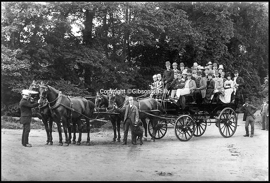 BNPS.co.uk (01202 558833)<br /> Pic: GibsonOfScilly/BNPS<br /> <br /> Warren's 'excursion car' offered rides for day trippers.<br /> <br /> An archive of eye-opening photographs documenting the grim reality of Poldark's Cornwall has emerged for sale for £25,000.<br /> <br /> More than 1,500 black and white images show the gritty lives lived by poverty-stricken families in late 19th and early 20th century Cornwall - around the same time that Winston Graham's famous Poldark novels were set.<br /> <br /> The collection reveals the lowly beginnings of towns like Rock, Fowey, Newquay and St Ives long before they became picture-postcard tourist hotspots.<br /> <br /> Images show young filth-covered children playing barefoot in squalid streets, impoverished families standing around outside the local tax office, and weather-beaten fishwives tending to the day's catch.<br /> <br /> The Cornish archive, comprising 1,200 original photographic prints and 300 glass negative plates, is tipped to fetch £25,000 when it goes under the hammer as one lot at Penzance Auction House.
