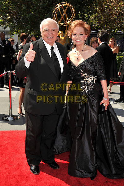 ERNEST & TOVA BORGNINE .Ernest Borgnine, the American film and television actor whose career spanned more than six decades, dies at the age of 95..File Photo: 61st Annual Creative Arts Emmy Awards held at Nokia Theatre LA Live, Los Angeles, California, USA, .12th September 2009..emmys full length couple married husband wife thumb up gesture black suit tie dress long maxi .CAP/ADM/BP.©Byron Purvis/Admedia/Capital Pictures
