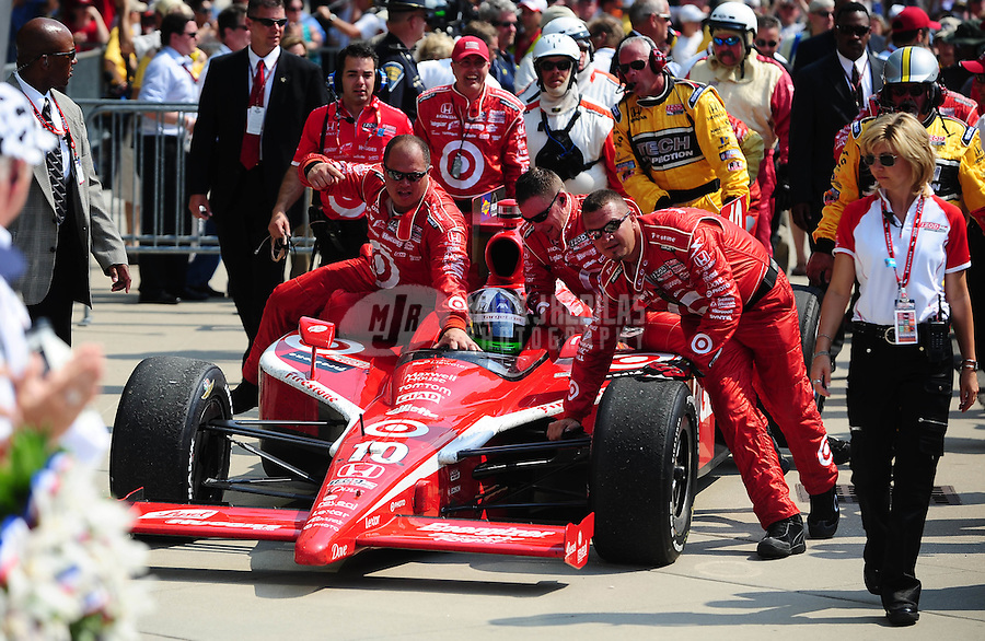 May 30, 2010; Indianapolis, IN, USA; IndyCar Series driver Dario Franchitti is pushed into victory lane by his crew after winning the Indianapolis 500 at the Indianapolis Motor Speedway. Mandatory Credit: Mark J. Rebilas-