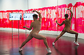 London, UK. 07/10/2015. Dancers Gareth Mole and Paolo Rosini perforeming. Eddie Peake: The Forever Loop opens in the Curve gallery at the Barbican Centre on 9 October 2015 and runs until 10 January 2016. In this free exhibition, Eddie Peake presents installations, choreographed performance of nude male and female dancers and video set-ups. EDITORIAL USE IN CONNECTION WITH THE EXHIBITION.