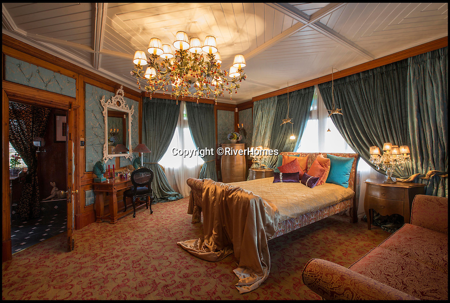 BNPS.co.uk (01202 558833)<br /> Pic: RiverHomes/BNPS<br /> <br /> One of the lavish bedrooms.<br /> <br /> The ultimate party pad...<br /> <br /> From the outside this 130-year-old Swiss chalet looks like a quirky old-fashioned property - but inside its the ultimate luxury home with a heated indoor beach, gold-covered bathroom and £500,000 kitchen.<br /> <br /> The Chalet Estate on the River Thames, next to Hampton Court Palace, is the ideal house for a wealthy party animal who wants to throw elaborate soirees.<br /> <br /> It is on the market with Riverhomes for £7.5million, but that's a bargain as the current owner has spent £4.7million completely overhauling the unusual property.