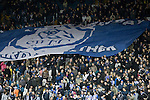 Supporters passing a large flag down the Kop stand before Sheffield Wednesday take on Peterborough United in a Coca-Cola Championship match at Hillsborough Stadium, Sheffield. The home side won by 2 goals to 1 giving Alan Irvine his third straight win since taking over as Wednesday's manager.