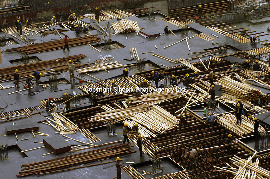 Formwork, reinforcement and concrete workers work in a residential site in Beijing, China..27-MAR-04