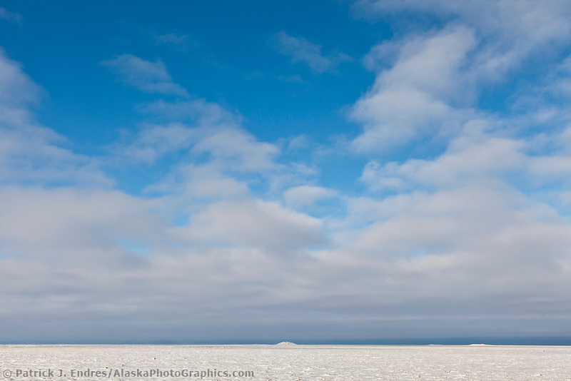 Geological feature known as a pingo on the snow covered tundra of the Arctic North Slope of Alaska.