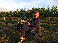 BNPS.co.uk (01202 558833)<br /> Pic ChrisNewman/BNPS<br /> <br /> Rachel Newman in the 6 acre vineyard.<br /> <br /> Heard it through the grapvine? - Kent property comes with a 4500 bottle vineyard.<br /> <br /> A charming farmhouse has emerged for sale which is perfect for wine lovers - as it has its own vineyard.<br /> <br /> Ulley Farmhouse in Kennington, Kent, comes with the neighbouring vineyard which produces 3,500 bottles of sparkling rose wine and 1,000 bottles of still rose each year.<br /> <br /> The vines were planted on the 5.75 acre farm by Chris and Rachel Newman 10 years ago, who have sold the wine through farmers markets.<br /> <br /> They are selling the property with estate agents Savills who have given it a pricetag of £1.35million.<br /> <br /> The Grade II listed five bedroom farmhouse dates back to the 16th century, with some later alterations.