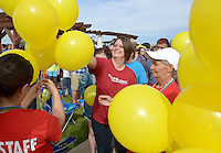 NWA Democrat-Gazette/BEN GOFF @NWABENGOFF<br /> Candice Anderson of Fayetteville, walking with the Love of Luke group, takes a balloon to release on Sunday Sept. 20, 2015 during the second annual Out of the Darkness Community Walk of Northwest Arkansas at Orchards Park in Bentonville. The fundraiser more than doubled in size this year, according to organizer Tyler West with the Arkansas Suicide Prevention Council, with 633 walkers raising $22,063 to help support suicide awareness and prevention efforts. Team Lexi Lives On walked in memory of Alexis Suzanne Riner, 15, who took her own life in June.